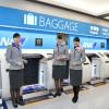 係員窓口より手荷物預け機に行列 写真特集・ANA新千歳空港新カウンター開業
