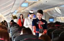歴代制服で亥年CAがサービス 写真特集・平成最後の初日の出フライト(JAL編)